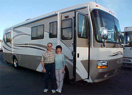 Two happy clients standing in front of there new Monaco RV purchased at Pedata RV